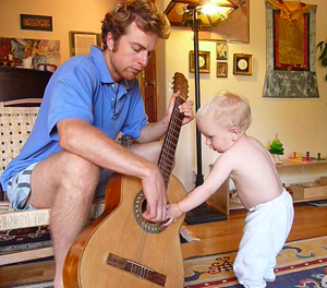Giving a guitar lesson to my nephew